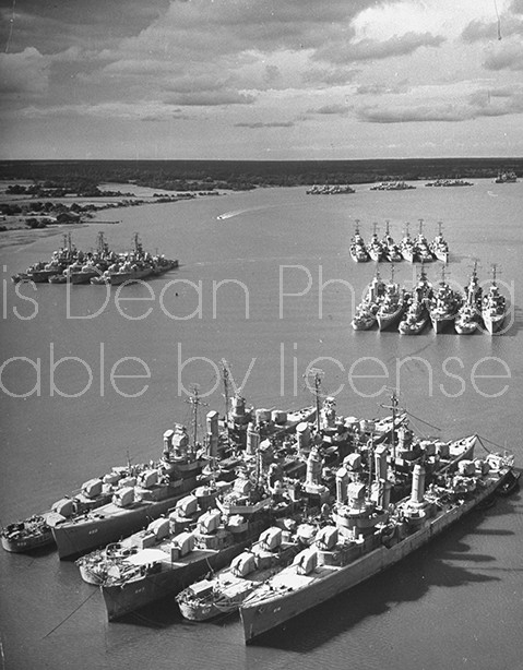 US naval ships docked in a floating storage depot.