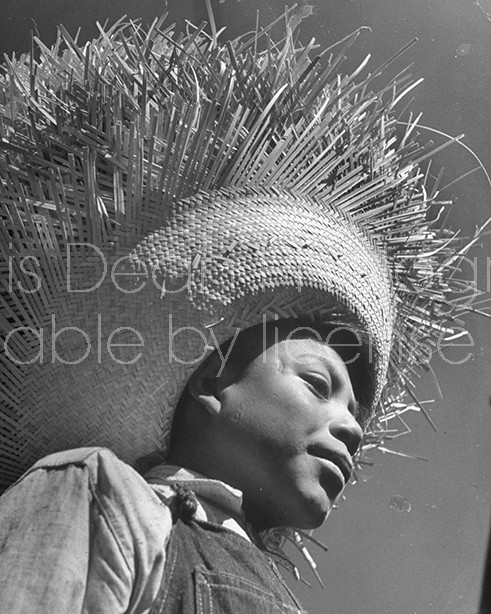 Loomis Dean Photography Vintage Editorial Stock Photos A Young Man Wearing A Large Straw Hat