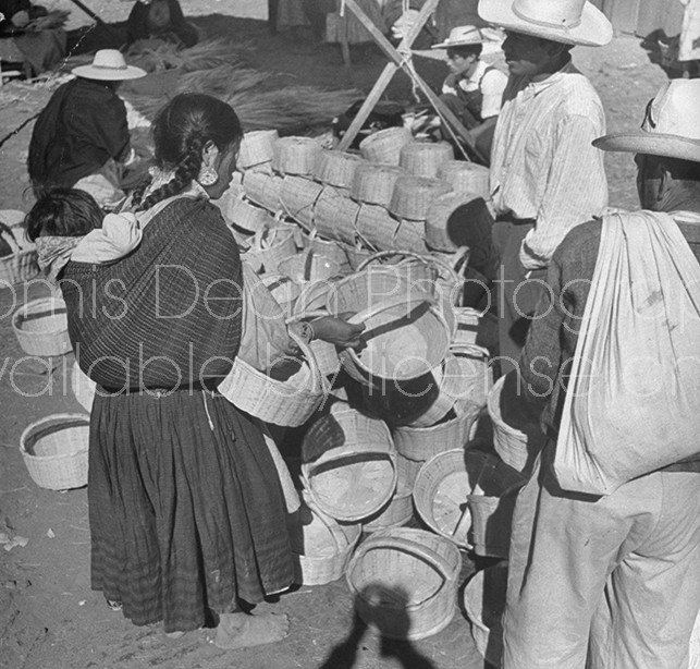 A woman choosing a basket in the Toluca Market.