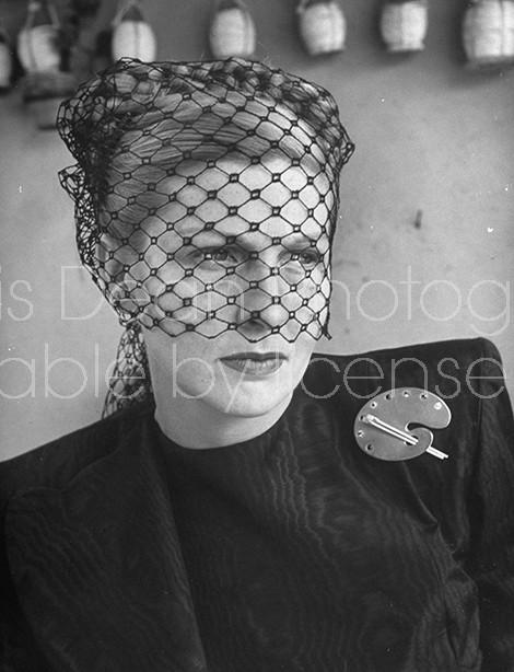 Widow Mrs. John Decker showing nostalgia and sorrow.