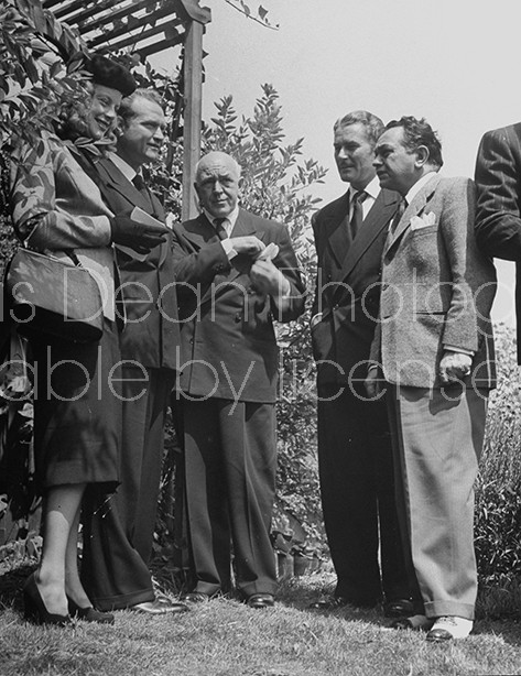 (L to R)Actors Red skeleton and his wife, Jimmy McHugh, Errol Flynn and Edward G. Robinson attending John Decker's funeral.