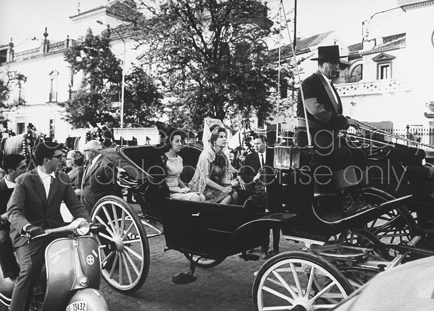Spanish Duchess of Alba riding in carriage, leaving bull ring.