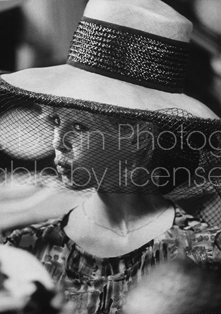 Actress Brigitte Bardot shopping for hats.
