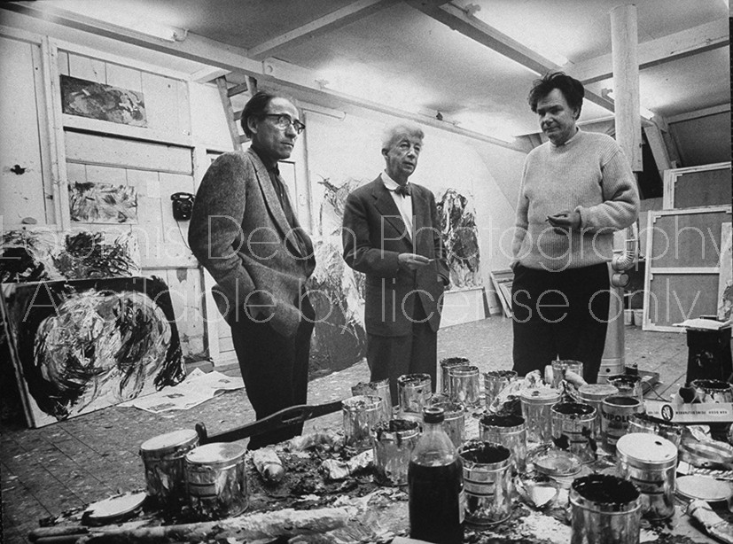 Painter Ger Lataster (L) with Artists  Willem Sandberg and Couzjins standing in the interior exhihbit of Museum.