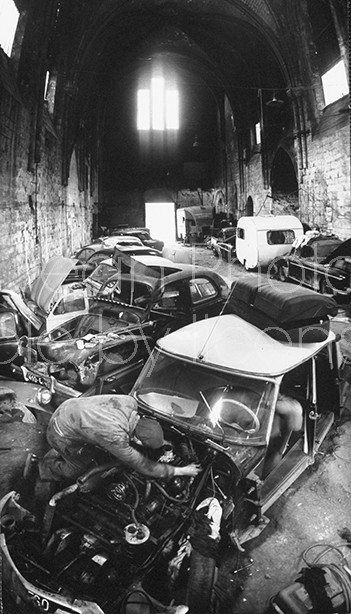 French Auto repair shop in Historic Saint Frombourg Church.