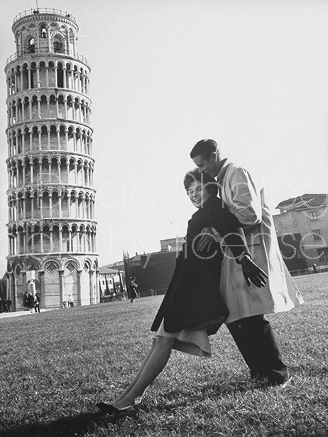 Leaning tower of  Pisa visited by Navy Lt. and wife.