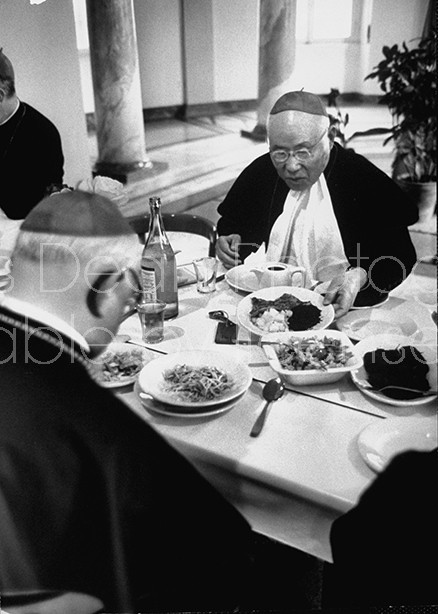 Cardinal, Thomas Tien, eating at seminary dining room, while in Rome to attend Ecumenical Council.