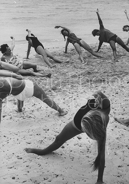 Members of French vacation Club Mediterranee doing exercises on the beach.