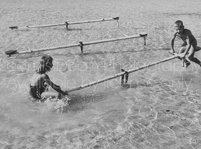 "children on vacation sea-sawing in the water at the ""Club Mediterranee""."