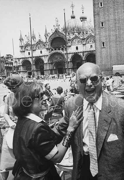 Detriot art collector Harry Winston (R), talking to the daughter of an Italian futurist painter.