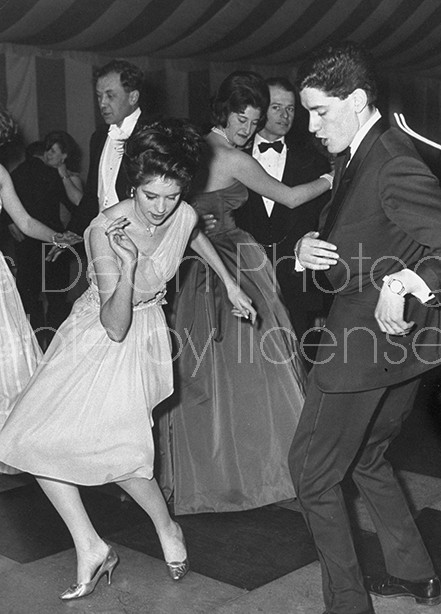Daughter of conservative party chairman Iain Macleod,Diana Macleod (L. Fore), twisting during her coming out party.