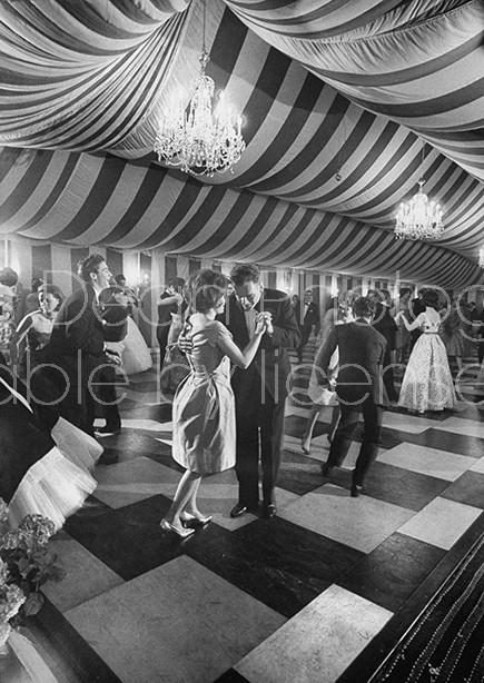 Guests dancing under chandeliers in made-to-order tent for Diana Macleod's coming out party.