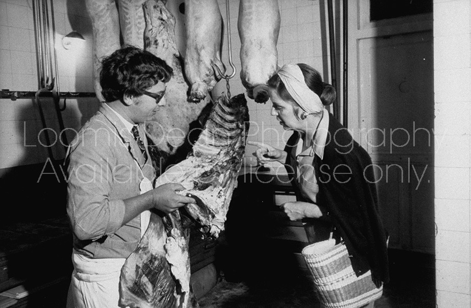 Woman shopper pricing beef at Boucherie Le Clerc in Paris France.