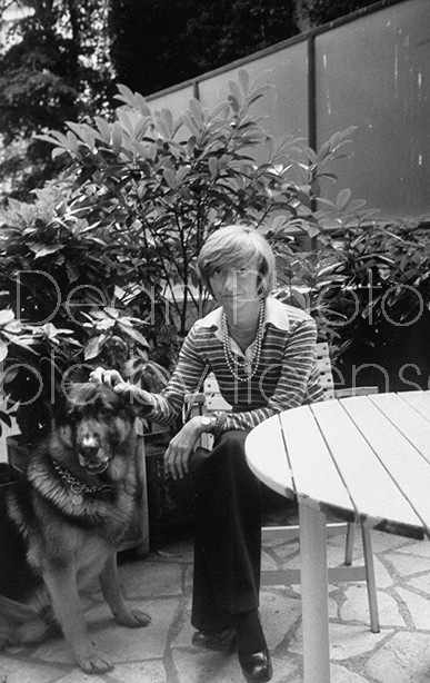 Writer Francoise Sagan posing for a picture at her home.