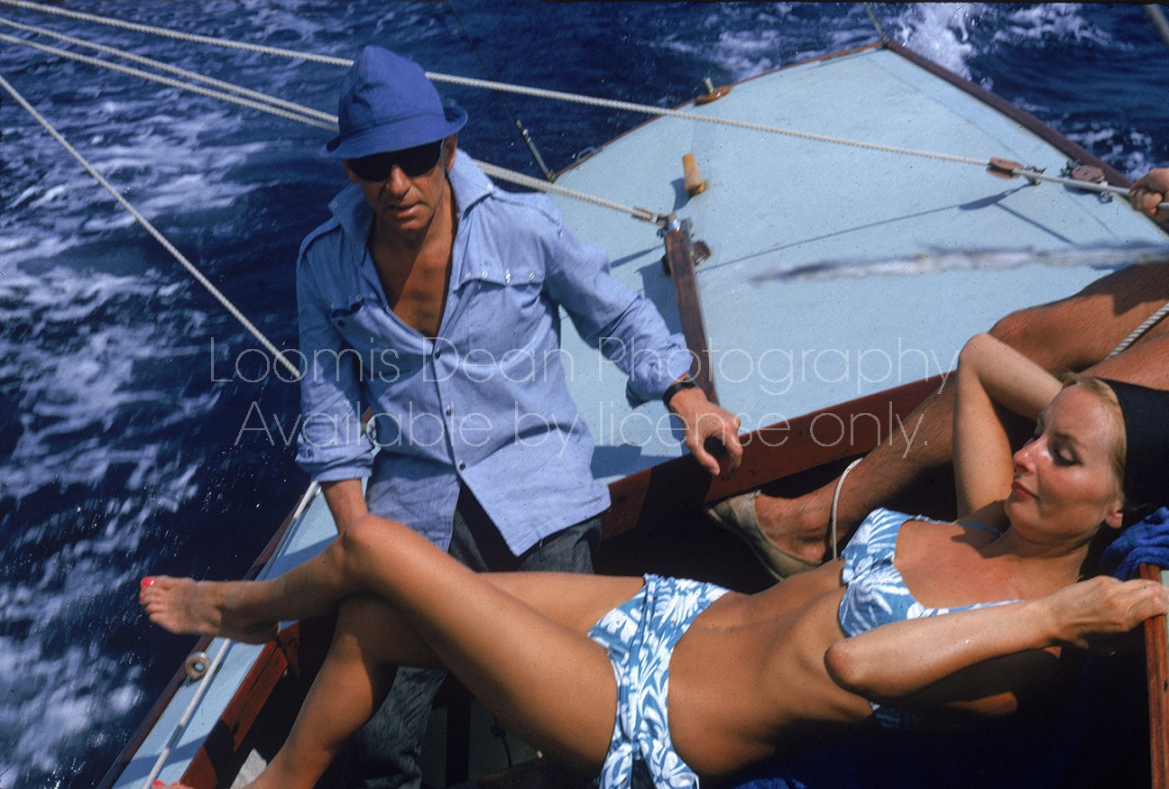 Conductor Herbert von Karajan and wife Eliette sailing on a boat.