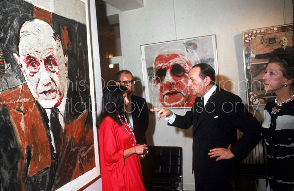 Minister of Culture Andre Malraux (2R), author Louise de Vilmorin (L), and gallery ownder Iris Clert (R) viewing exhibit of Boris Vansier's portraits of de Gaulle.