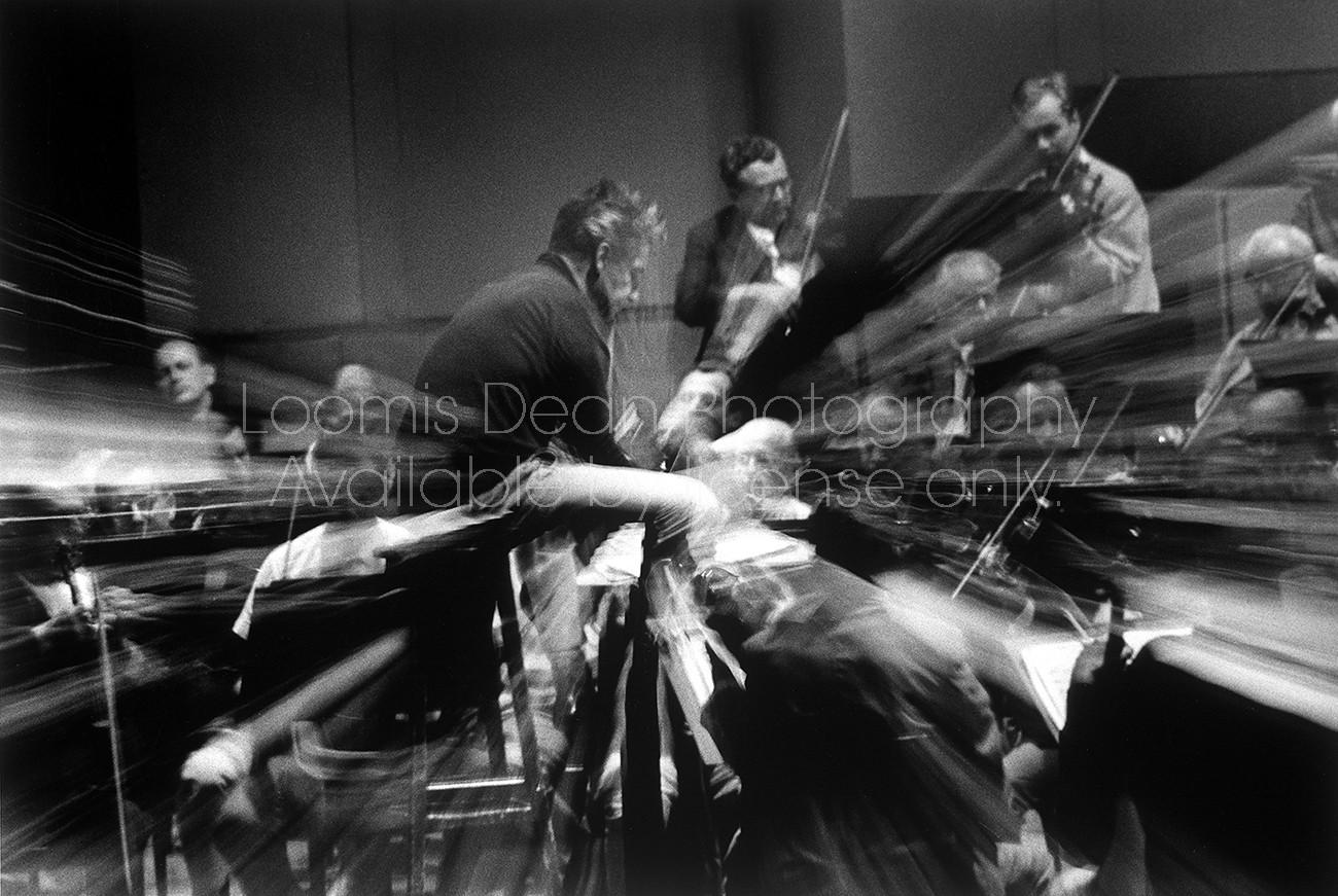Conductor Herbert Von Karajan rehearsing the Berlin Philharmonic