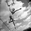 Trapeze artist Nina Otaris swinging in air during her performance.