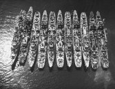 US naval Destroyer escorts docked in a floating storage depot.