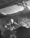 Nightclub singer Joan Nichols (C) performing her act.