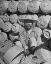 A baskets vendor sitting among his wares in the Toluca Market.