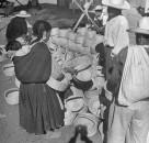 A woman choosing a basket in the Toluca Market.