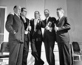 Pres. Pepsi Cola Co. Walter S. Mack Jr. (C) standing with other members of the firm.