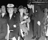 """Pres. Pepsi Cola Co. Walter S. Mack Jr., greeting one of the 8000 stockholders who came from 29 states to the """"Pepsi-Cola Family Party."""""""