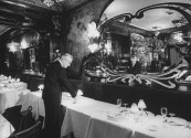 Maxim's Paris owner Louis Vaudable, checking table setting.