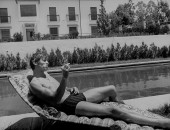 Spanish bullfighter Manuel Benitez aka El Cordobes, while relaxing by the pool.
