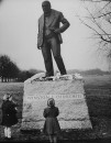 A 9-ft. statue of Sir Winston Churchill, is visited by young girls mourning his death.