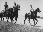 Spains's Duchess of Alba riding horses with her sons.