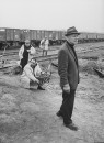 "United artist special effects man Lee Zavitz (Fore), on location for explosion scene in film ""The Train""."