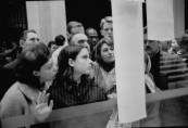 Crowds reading bullentins of John F. Kennedy's assassination outside the US Embassy .
