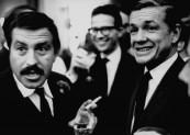 New York Herald tribune columnist, John Crosby (R), attending reception for Gunther Grass.