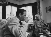 Actress Margaret Rutherford (R) having tea with a local minister.