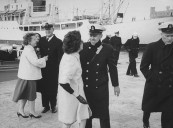 US Navy officers being greeted by families.