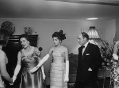 Daughter of conservative party chairman Iain Macleod,Diana Macleod (C) and her parents, receiving her guests at her coming out party.