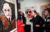 Minister of Culture Andre Malraux (2R), author Louise de Vilmorin (L), and gallery ownder Iris Clert (R) viewing exhibit of Boris Vansier's portraits of de Gaulle.
