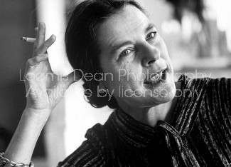 Closeup of Novelist, Mary McCarthy w. cigarette in hand propped against her head, talking candidly at her apartment, Paris, France.