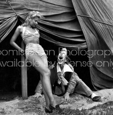 Star clown Lou Jacobs looking up at a showgirl.
