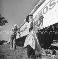 Clown Frank Saluto (R) helping to paint a sign for the circus.