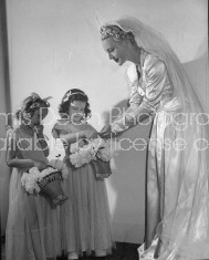 Bride standing with flower girls at West Point wedding ceremony.