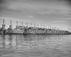 US naval LSM's docked in a floating storage depot while the docks are repainted.