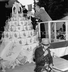 Charles F. Kettering (Top) preparing to cut the cake for celebration of his birthday in his home town.