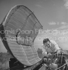 Bandleader Guy Lombardo working on his motorboat.