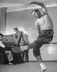 Dancer Jerome Robbins dancing during rehearsal with Elmer Bernstein at the piano.