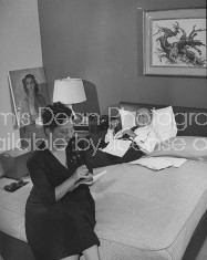 A.C. Blumenthal lying on his bed while his secretary recites his notes.