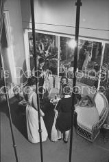 Debutantes Elisabeth de Choiseul-Preslin (L), Therese de Clermont-Tonnerre (C), and Brigitte Contat-Destontaines (R) having ball gowns fitted at Jacues Heim Boutique.