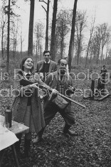French Marquis D'angossee Mieuelle smoking cigar during hunt on his country estate w. debutante daughter, Diane.